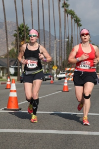 Krista Miner Sidwell and Natalie Brown in the last half mile of the 2014 Canyon City Marathon sprinting for the finish.
