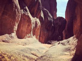 My husband hiking through the Fiery Furnace